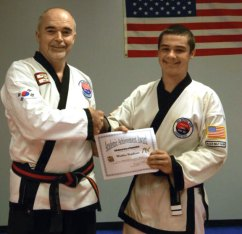 Matthew Hopkinson of Beacon Falls receives the USA Martial Arts Academic Achievement Award for the 10th consecutive year from Master Doug Wilke. The award is given to USA Martial Arts students who earn honor roll status at their respective school. Hopkinson is a sophomore at Woodland Regional High School and the son of Mark and Wendy Hopkinson of Beacon Falls. -CONTRIBUTED
