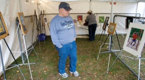Frank Hayden of Naugatuck looks over a photography exhibit during the Naugatuck All Arts Festival last year. The Naugatuck Arts Commission has teamed up with the Naugatuck Cultural Council this year to host an Arts & Cultural Festival on the Town Green Saturday. –RA ARCHIVE