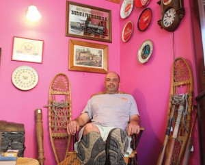 Sam Montville of Naugatuck sits in his consignment boutique, Hawkins Galleries, on Church Street Aug. 2. –ELIO GUGLIOTTI