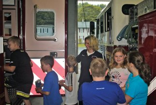 Campers from United Day School in Beacon Falls donated a $300 check to Beacon Hose Company No. 1 Aug 22. The campers raised $200 at a lemonade stand in July and the school pitched in an additional $100. The money will be split evenly between the fire department and ambulance company. –ELIO GUGLIOTTI