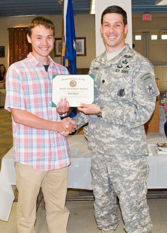 Jensen Mezzio of Naugatuck receives the U.S. Army Youth Volunteer Award from Lt. Col. Michael Coleman, commander of the U.S. Army Recruiting Battalion in Albany, N.Y., Aug. 6 at the Naugatuck Senior Center. –LUKE MARSHALL