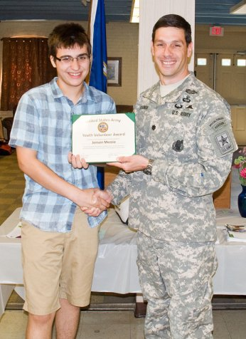 Nick Ryan of Naugatuck receives the U.S. Army Youth Volunteer Award from Lt. Col. Michael Coleman, commander of the U.S. Army Recruiting Battalion in Albany, N.Y., Aug. 6 at the Naugatuck Senior Center. –LUKE MARSHALL