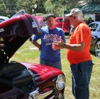 Dick Ludecke, left, of Prospect talks about his 1948 Ford Convertible with Will Douchet of Wolcott last year during Prospect's annual Sock Hop and Car Show on the Green. This year's show is Sunday. -FILE PHOTO