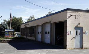 Naugatuck is claiming ownership of this building at 246 Rubber Ave., which is currently occupied by Naugatuck Ambulance and the Department of Public Works. –RA ARCHIVE