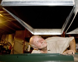 Robert Juliano of Naugatuck takes a look at the ductwork for his new furnace at his home in Naugatuck Wednesday. –RA ARCHIVE