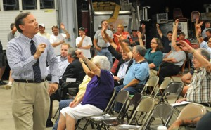 Beacon Falls Selectman Christopher Bielik counts votes during a town meeting Tuesday night at Beacon Hose Company No. 1. Voters authorized the town to borrow up to $1.82 million for three separate projects. –LUKE MARSHALL