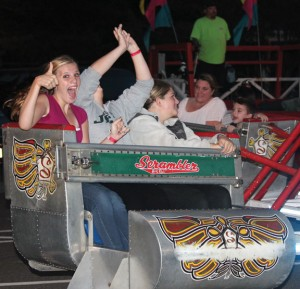Brianna Hudson gives the thumbs up as she rides the Scrambler with Brianna Rubino, center, and Ashley Frenette during the Prospect Congregational Church's annual Carnival and Fall Festival last year at the church on Center Street. This year's festival is this weekend. –FILE PHOTO
