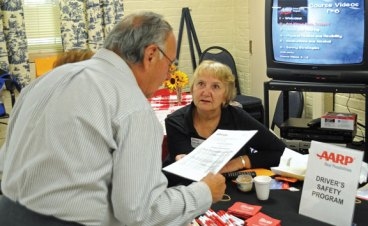 The Naugatuck Senior Center and the Naugatuck Savings Bank Foundation presented the annual Naugatuck Valley Senior Day Sept. 19 at the senior center on Meadow Street. The event featured over 40 informational booths. Senior center member Alfonso Olivo, left, talks with AARP representative Diana MacKenzie. The AARP was handing out literature about a senior driver safety program. –LUKE MARSHALL