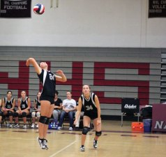 Naugatuck's Kait Barry (24) jumps for the kill as Stefani Barry (34) looks on Sept. 20 versus Wilby in Naugatuck. Naugatuck beat Wilby, 3-0, and is 6-1 on the year. –ELIO GUGLIOTTI