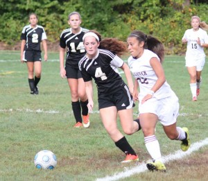 Naugatuck's Stefanie Flores (22) brings the ball up field as Woodland's Audra Blewitt (4) defends Sept. 13 at Breen Field in Naugatuck. Woodland's Sonia Sousa (2) and Hailey Borris (14) along with Naugatuck's Taylor Campos (15) keep a close eye on the action. Woodland defeated Naugatuck, 1-0. –ELIO GUGLIOTTI