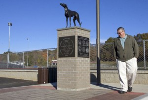 Naugatuck Mayoral Aide Ed Carter checks out the new greyhound statue at Veterans Field at Naugatuck High School Oct. 25. Carter helped to raise money for the project by selling engraved bricks that are placed around the statue. –RA ARCHIVE