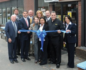 Dickey's Barbeque Pit general manager Nadia Valentin, center, flanked by Dickey's new owners Robert and Bonnie Cacioppo celebrate the restaurant being under new ownership with a ribbon cutting ceremony along with local dignitaries Oct. 11 at the restaurant on Rubber Avenue in Naugatuck. –LUKE MARSHALL