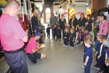 On Oct. 17 St. Francis-St. Hedwig preschool students visited Naugatuck fire headquarters on Maple Street to learn about fire safety and firefighters worked with the students to make sure the children aren't scared of firefighters when they are in their full gear. –LUKE MARSHALL