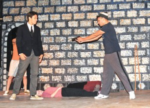 Hamlet, played by Preston Bogan, right, confronts Claudius, played by Troy Bond, as Ophelia, played by Katie Stango, lies dead on the ground during a rehearsal for  Naugatuck Teen Theater's production of 'Hamlet vs. Zombies: Something is Rotting in the State of Denmark' Tuesday night. The play opens Oct. 26 at St. Michael's Church, 210 Church St., in Naugatuck. –LUKE MARSHALL