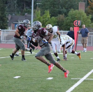 Naugatuck's Kevin Robinson turns the corner on his way to an 82-yard touchdown run on the Greyhounds' first offensive play Sept. 26 at home versus Sacred Heart. The opening touchdown sparked the Greyhounds to a 49-19 victory. -ELIO GUGLIOTTI