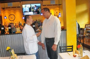 Gang Guo, owner of New Harvest in Beacon Falls, talks with First Selectman Gerard Smith Oct. 18 during the restaurants' first night open for business. –LUKE MARSHALL