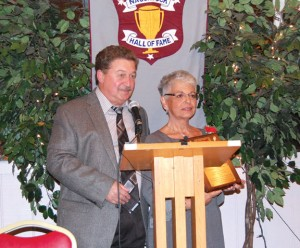 Pat Lawlor, right, accepts a plaque from Naugatuck Hall of Fame committee member Fred Scheithe on behalf of her late husband, Pete Lawlor, Oct. 19 during the Hall of Fame's 42nd induction ceremony at Continental Room in Naugatuck. Pete Lawlor was among the seven new members inducted this year. –KEN MORSE