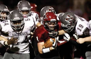 Torrington's Zack Mancini, right, hangs onto the ball as a host of Naugatuck defenders, including, Socrates Illunga (54) and Chris Quarles (19) take him down Oct. 11 in Torrington. The Greyhounds won the game, 33-3. –RA ARCHIVE