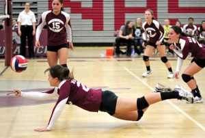 Naugatuck's Kayla Rotatori dives for a dig Oct. 10 versus Woodland in Naugatuck. The Greyhounds beat Woodland, 3-1, and handed the Hawks their first loss of the season. –ELIO GUGLIOTTI