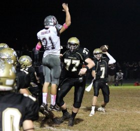 Woodland quarterback Tanner Kingsley (7) and the Hawks face Morgan in the quarterfinals of Class S football playoffs Tuesday night in Beacon Falls. –FILE PHOTO
