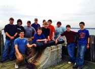 Naugatuck and Prospect Boy Scouts from Troop 102 recently spent a weekend camping at Fort Nathan Hale on east shore of New Haven Harbor in New Haven. The scouts performed a good turn by cleaning up beach front. From left, Assistant Scoutmaster John Llauer, Assistant Scoutmaster Zack Blum, Nick Hanks, Assistant Scoutmaster Kyle Fellows, Javon Brady, Justin Wagner, Terry Ellingson, Jesse Bronko, John Llauer, Trevor Aresta, Nicky Llauer and Ethan Maxwell pose for a picture at the point which Black Rock Fort was constructed in 1776 to protect Port of New Haven. For more information on Troop 102 or scouting, visit any troop meeting on Thursdays from 7 to 9 p.m. at the Naugatuck Congregational Church on Division Street. –CONTRIBUTED
