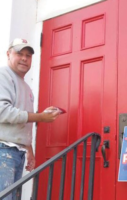 Local painter Steve Kijak recently donated his services to restore the front doors of the United Methodist Church on Meadow Street in Naugatuck. The 150-year-old wooden doors needed extensive preparation to restore them. -CONTRIBUTED
