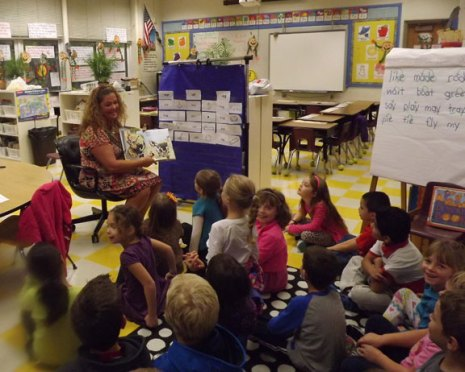Karen Ambari of the Beacon Falls Rotary Club reads to students at Laurel Ledge Elementary School in Beacon Falls Nov. 1. Guest readers from throughout the community visited the school to read to classes as part of CT Loves to Read Day. -CONTRIBUTED