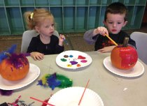 Children decorate pumpkins at the Naugatuck YMCA last month. The YMCA hosted a fall festival in October. Children in Toddler Time decorated pumpkins, and apples were the theme of the day in the preschool room. The children sold apples at their apple stand, ate apple smiles and painted apple prints. Along with the festival, the month featured vacation camp on Columbus Day during which children picked pumpkins, collected leaves and played kickball game. The after school children made fall decorations for their room, and an intermediate school open Y night was held Oct. 26. –CONTRIBUTED