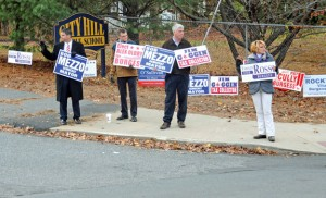 From left, Naugatuck Mayor Robert Mezzo, Burgess Alex Olbrys, Tax Collector Jim Goggin and Deputy Mayor Tamath Rossi campaign at the entrance to City Hill Middle School in Naugatuck on Election Day. –FILE PHOTO