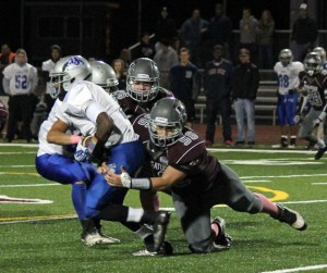 Naugatuck senior Kevin Mariano (56) has carried on the family tradition of wearing the Garnet and Grey for the Greyhounds. –ELIO GUGLIOTTI