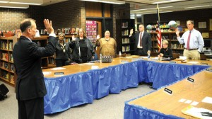 Borough attorney Ned Fitzpatrick swears in members of the Board of Education at its Nov. 14 meeting at City Hill Middle School. –LUKE MARSHALL