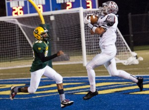 Naugatuck's Bryan Coney catches a touchdown pass in front of Jordan Perry (89) of Holy Cross Nov. 8 at Municipal Stadium in Waterbury. The Greyhounds topped the Crusaders, 56-20. –RA ARCHIVE