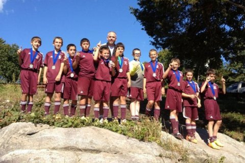 Naugatuck Elite Extreme, the Naugatuck Youth Soccer U12 boys competition team, advanced to the Connecticut Cup Championship with a 3-1 road victory over Guilford Oct. 26. Elite Extreme will go on to play Madison Gold for the Connecticut Cup Championship on Saturday, Nov. 2 at 2:15 p.m. at the Farmington Sports Arena, 11 Executive Drive, Farmington. The team, which is undefeated, has won its last three tournaments, the South County RI Seaside Classic, Naugatuck SPIN and Madison MIST tournaments. Pictured: Naugatuck Elite Extreme pose for a picture after winning the Madison MIST Tournament earlier this year. Standing in back, head coach Glenn Connan, from left, Ethan Lopes, Connor Kusmit, Branden Lage, Brandon Sampaio, Matt Smith, Nelson Lavoura, Michael Connan, Dylan Gloden, Brian Portela, Freddie Longo and Brian Silva. Missing from picture, Zach Koslosky, Alex Manasoiu and Eduardo Garcia. –CONTRIBUTED