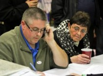 Mayoral Aide Ed Carter, left, records elections results at the Naugatuck Democratic headquarters on Church Street Tuesday night as former Mayor Joan Taf looks on. –ELIO GUGLIOTTI