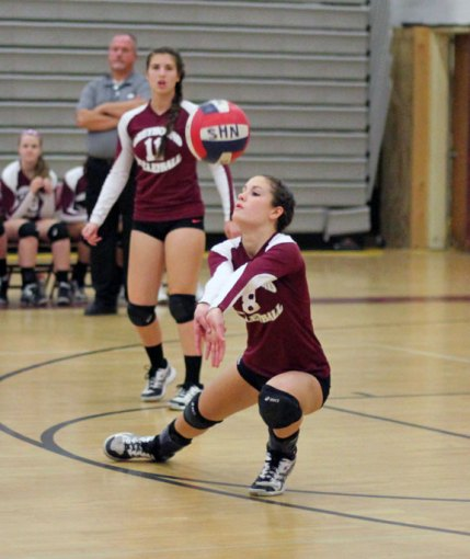 Naugatuck's Ashley Whitney (8) lunges for a dig Nov. 4 night versus Bristol Central during the opening round of Class L volleyball tournament at Naugatuck High. Bristol Central won the match, 3-1. –ELIO GUGLIOTTI