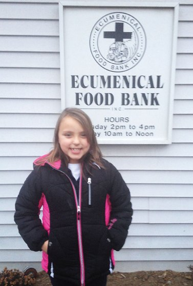 Hannah DeCampos, 7, of Naugatuck, recently walked throughout her neighborhood collecting donations for the Naugatuck Ecumenical Food Bank. DeCampos, who wanted to help out because she heard children were in need, collected over five boxes of food donations and $150 for the food bank. –CONTRIBUTED