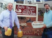 Safe Haven of Greater Waterbury Associate Director Lee Schlesinger, left, and Daniel Whitman of Naugatuck unload desserts and juices Nov. 27 for a Thanksgiving meal at Safe Haven. Whitman has donated food to Safe Haven to prepare a Thanksgiving meal for the past three years. This year Whitman and Robert Cacioppo, owner of Dickey's Barbecue Pit in Naugatuck, split the cost of having a meal catered for the organization. – CONTRIBUTED