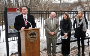 Naugatuck Mayor Robert Mezzo, left, addresses the crowd at the official opening ceremony for the first section of the Naugatuck pedestrian greenway Dec. 20 on the Gen. Pulaski Bridge as ,from left, state Sen. Joseph Crisco, (D-17), state Rep. Rosa Rebimbas (R-70) and state Sen. Joan Hartley (D-15) look on. –LUKE MARSHALL