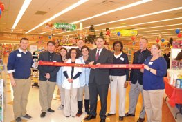 Naugatuck Mayor Robert Mezzo, surrounded by Rite Aide employees, cuts the ceremonial ribbon to signify the grand re-opening of the store at 56 Rubber Ave. Dec. 6. The drugstore was recently updated and rearranged to bring it in line with other, newer Rite Aide stores. The store gave out gift bags, coffee and donuts to the customers who came in during the ceremony. –LUKE MARSHALL