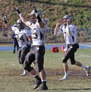 Woodland's Chris Slavin (34) Colby Vaccarelli (25) and Tanner Kingsley (7) celebrate after Kingsley scored the go-ahead touchdown Nov. 29 versus Seymour at Seymour High School. The Hawks defeated Wildcats, 22-19, in the annual Thanksgiving game. -RA ARCHIVE