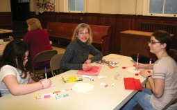 Naugatuck residents and members of Salem Lutheran Church, from left, Londyn Burger, Carolyn Burger and Lauren Burger participate in the 7th Annual Trumbull-Porter Chapter DAR Valentine workshop Jan. 11 at the church. Over 190 Valentine cards were made during the workshop that will be distributed to the veterans at the VA Hospitals in West Haven, Rocky Hill and Newington as part of the National Society Daughters of the American Revolution (NSDAR) Salute to Hospitalized Veterans. Over 50 pounds of candy was collected and then bagged to be given as favors for the veterans as well. Another 19 pounds of hard candy was donated to be shipped to active duty service men and women. –CONTRIBUTED