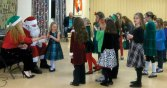 Santa visited with dancers from the Horgan Academy of Irish Dance in Naugatuck Dec. 21. Pictured with Santa is Irish dance teacher Irene Horgan. -CONTRIBUTED