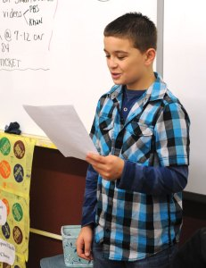 Hillside Intermediate School sixth-grader Adrian Aleskiejczuk reads the answer to a math quiz during class Jan. 13 at the school in Naugatuck. Over the past four years, Hillside has risen from being labeled a failing school under the federal No Child Left Behind act to the top performing school in the district. –LUKE MARSHALL