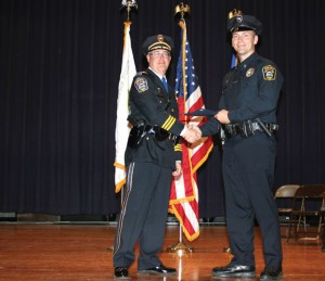 Naugatuck police Det. Sean Simpson, right, is retiring after 20 years. He is seen here receiving an award from Police Chief Christopher Edson. –CONTRIBUTED