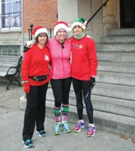 From left, Naugatuck YMCA Youth and Family Director Sherri Beck, Health Director Lori Czajkowski and YMCA member Debbie Rescanski pose in front of the YMCA on Church Street before going on a 5K run on Christmas Eve morning. The YMCA is hoping to make the run an annual event. -LUKE MARSHALL