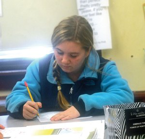 Hillside Intermediate School sixth-grader Jordyn Hunt takes a math quiz Jan. 13 at the school in Naugatuck. Over the past four years, Hillside has risen from being labeled a failing school under the federal No Child Left Behind act to the top performing school in the district. –LUKE MARSHALL