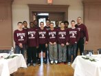 The Naugatuck High School freshmen boys basketball team volunteered at St. Michael's Episcopal Church in Naugatuck Christmas Eve to help the Naugatuck Christmas Day Dinner Committee prepare for its annual Christmas dinner. Pictured, from row from left, John Krupnik, Robert Shannon, Tyler Deitelbaum, Steve Marinaro, Alijah Garris and Josh McFarland. Back row from left, Brian Moore, Rockeim Dukes, Kyle Soucey, Dan Oladapo, Mike Green and coach Brett Hayward. –CONTRIBUTED