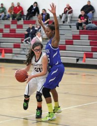 Naugatuck's Jackie Aronin (00) backs down Crosby's Za'nayia Love in the lane Jan. 28 in Naugatuck. Naugy won the game, 37-29. –ELIO GUGLIOTTI