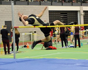 Woodland's Matthew Butterworth competes in the high jump during the NVL indoor boys and girls track championships Jan. 28 at the Floyd Little Athletic Center at Hillhouse High School in New Haven. The Woodland boys came in second at the meet. –LUKE MARSHALL