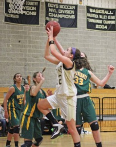 Woodland's Andrea Piccolo (22) is averaging 12.9 points per game this season as the Hawks' go-to player on the court. –FILE PHOTO